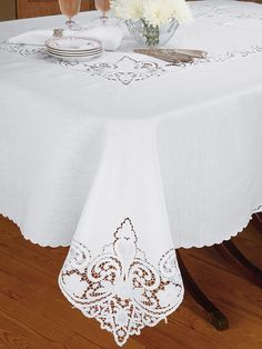 Seville - Fine Table Linens  The extravagant beauty created by skillfully handcrafted open cutwork is at its most elegant on this luxurious Italian linen tablecloth. From the paisley swirls to the exquisitely cut flowers, the glorious centerpiece, edge and corner motifs are all truly works of art. Imported in White, with generously sized napkins to match.
