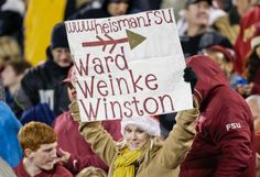 A Florida State fan holds up a sign in support of Jameis Winston. (Bob Leverone/AP)