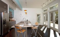The kitchen of the 'Origin' house by Blu Homes.  A lot of space, a lot of light.