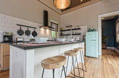 Love the Smeg fridge and oversize tile in this kitchen..