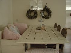 Pallet / Wood diy table and sitting nook.  Love the couch up next to table- unique look.