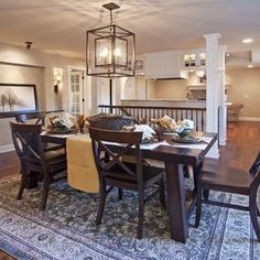 in this stunning dining room, three holly hunt light fixtures are