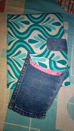 Used fabric and denim to make a  phone pouch and a journal cover...