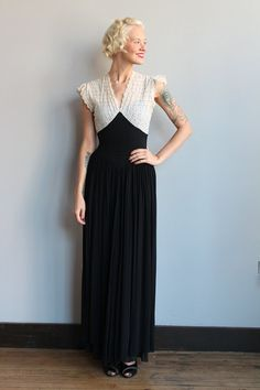 ~Breathtakingly stunning 1940s Gown ~Fully lined ~White Eyelet bodice, with a blue silk slip ~Black silk chiffon ~Side metal zipper ❉ measurements:  fits like: Xsmall bust: 34 waist: 25-26 Dropwaist yoke: 30 shoulder: 15 length: 60  ❉ All measurements are taken in inches. Please ensure fit before purchasing. All sales are final. No returns or exchanges.  brand/maker: // material: Cotton bodice, Silk Skirt condition: Amazing condition for its age! One teeny hole in bottom skirt, this is not…