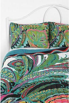 Tropical bedding  vibrant paisley for a younger, fresh beach decor.