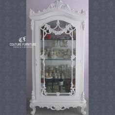 Chateau de Coquille Display Cabinet (SGD$1480) | Gorgeously glamorous, this Chateau de Coquille Display Cabinet is a complete gem. Beautifully detailed with several internal shelves, glazed door and sides. Made of solid wood and an absolute bargain! | All Couture Furniture designs are fully customisable in a range of sizes, colours, graphic prints and fabric. | Image belongs to CF client: Shirley