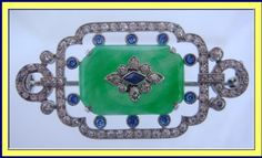 Dreicer & co. brooch with jade, diamonds and sapphires, c. 1922.  This was probably made in the last couple of years of the firm's existence, before they were bought by Cartier.