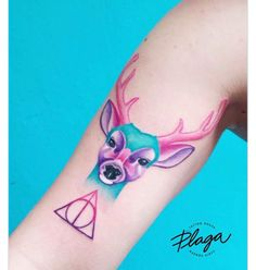 Harry Potter tattoo. Deathly hallows symbol tattoo. Patronum tattoo. Deer tattoo. Coloured tattoo. Colored tattoo.