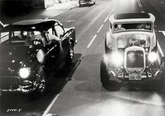 American Graffiti Milner's Ford Coupe races Falfa's Chevy down street Poster – Shopping Guide Rat Rods, Epic Film, American Graffiti, 32 Ford, Harrison Ford, Hot Cars, Ducati, Custom Cars, Classic Cars