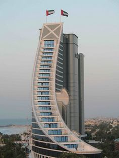 Jumeirah beach hotel. @Deidra Brocké Wallace. #architecture #buildings #hotels http://www.pinterest.com/TheHitman14/architecture-%2B/ Der Ganzen Welt, Dubai Architecture, Agence Architecture, Beautiful Architecture, Architecture Design, Building Architecture, Amazing Buildings, Unusual Buildings, Modern Buildings