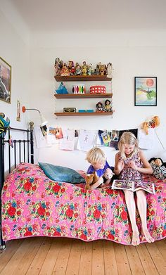 lovely kids bedroom- love the hanging art display, the shelves and the quilt