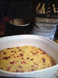 Vi-Crunch Tri-berry Protein Bars:  1 cup organic PB, 1/2 cup honey, 1 1/2 cup regular oats, 2 scoops vi shape shake mix, 1/2 cup tri-berry puffs vi crunch fusions. Add some vi crunch sweet almond flavours and chocolate macadamia granola on top. Mix together the PB and honey. Heat for 30 seconds then add shake mix. Then add oats and cereal.  Spread into a casserole dish. Refrigerate and serve. Cut into bars.