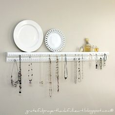 I like necklaces.  I wear one every day.  I have a lot.  They hung from door knobs... over hooks...  and hangers everywhere.  The problem: ...