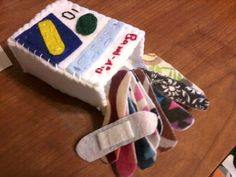 felt bandaids made with velcro pad so it could stick to stuffed animals. Great idea!