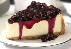 """This is a dense cheesecake that is very smooth and melts in your mouth. The white chocolate brandy sauce tops it off. I just nap it over the center of the slice of cheesecake on Cheesecake Day, Blueberry Cheesecake, Cheesecake Recipes, Dessert Recipes, Classic Cheesecake, Protein Cheesecake, Blueberry Cake, Yummy Treats, Delicious Desserts"