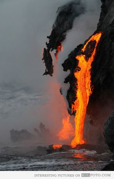 Lava flows into the ocean - Amazing picture of lava flowing and falling into the ocean.