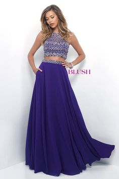 Gorgeous chiffon two piece that features a fully beaded bodice, beaded waist, and a darling pocket detail. Back zipper closure.