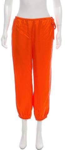 Orange Halston Heritage satin jogger pant with elastic waistband, dual slit pockets at side seams, elastic pant cuffs and drawstring detail at side seam. Cuffed Pants, Jogger Pants, Harem Pants, Pajama Pants, Pant Cuffs, Satin Joggers, Halston Heritage, Athletic Pants, Women