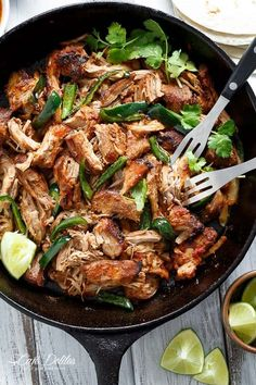 Crispy Slow Cooker Carnitas (Mexican Pulled Pork) so tender an falling apart smothered in so much flavour, you won't be able to put your forks down![br]