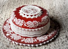 So beautiful, such a lot of work! Stringwork, brush embrodery, piping, all on gorgeous ruby red.