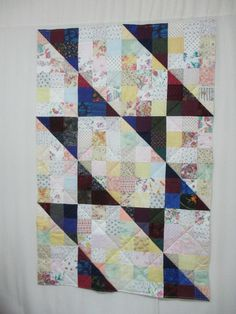 Half-Square Triangles quilted on DSM 2015