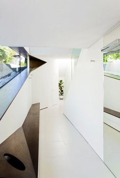 slope-roof-house-with-futuristic-interiors-framing-the-landscape-8.jpg