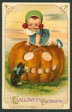 That creepy child is terrorizing that poor kitten. | 13 Adorable Vintage Cats Celebrating Halloween