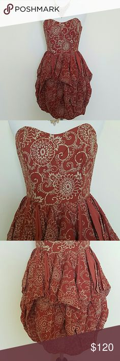 French Connection Bubble Hem Dress This is such a cute dress! Rusty red colored with cream floral design, a bubble hem and boning in the top for support! NWT! Thanks for looking! French Connection Dresses Mini