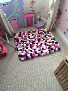Pompom rug (a few odd yellows as ran out of the  colours) girls LOVE it!!!