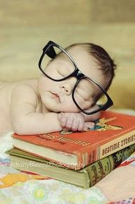 Bookworm baby pose. It would be cute for Abby to pose on a cool copy of To Kill a Mockingbird...maybe without the glasses?