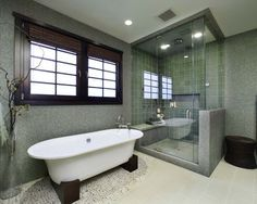 Modern bathroom with loose standing bath and big frameless shower