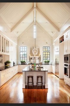 Gorgeous kitchen. Especially love the beams and track lighting.