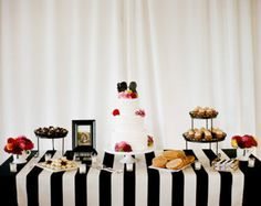 The all white backdrop is perfect with this black and white stripe tablecloth