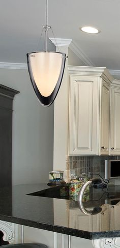 arteriors sabine 1 light pendant in clear glass 2 kitchen photo by kenroy home homeclick community