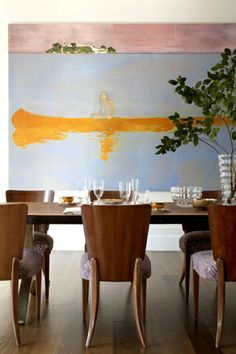 Peter Doig painting in dining room /Katie Lydon Interiors