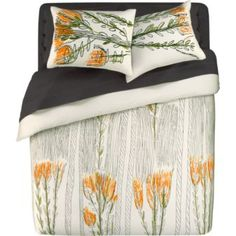 I don't think Z would ever go for these linens, but I like the idea of a light pattern with dark solid sheets.