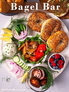 A bagel bar is simple and easy to set up for brunch, breakfast, bridal shower, Christmas morning or any kind of party or for out of town guests.  The ultimate build your own DIY breakfast or brunch.  Great for picnics too.  Use full size and mini bagels with different flavors of cream cheese, smoked salmon, any thing goes on this menu. OnTheGoBites.com #bagelbar #easybrunch