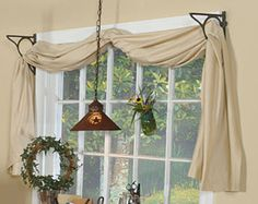 Install open-centered shelf brackets on either side of a window to hold a simple swag-style treatment.  Find more great decorating secrets in every issue of Country Sampler. Order your subscription here: https://ssl.drgnetwork.com/ecom/csl/app/live/subscriptions?org=csl&publ=CS&key_code=EYJCS02&source=pinterest