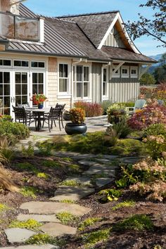 Love the stone path winding down to the patio.