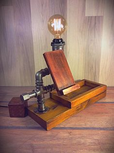 Unique Table Lamp, Wood station, Home Phone holder, Wood Docking Station Lamp, Item Details = Wood station = iron pipe & fittings = 60 Watt max = Tint brown colour = Base of pine = Phone holder of mahogany =. Bulb not included Dimensions. Steampunk Table, Lampe Steampunk, Steampunk Design, Unique Table Lamps, Rustic Lamps, Lampe Tube, Pot Mason, Pipe Decor, Wooden Organizer