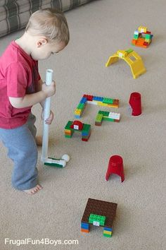 """Here's a fun way for preschoolers to expend some excess energy on a day stuck indoors – Duplo Lego Mini Golf! We used a ping pong ball for our golf ball – I didn't want a real golf ball flying through the house! We used plastic cups for the """"holes,"""" although Jonathan (age 3) was …"""