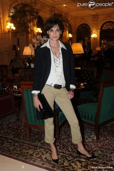 Ines de la Fressange. Now that's some layered necklaces! Notice the cuffs--both sets.
