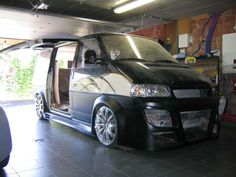 VW T4 with a custom lift up side door!