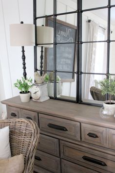 Mirrored windows to make this little dining room feel bigger