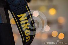Macro shot of Nikon camera strap against bokeh Christmas lights background