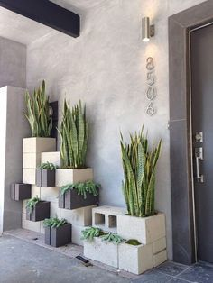 Eclectic Front Door with exterior stone floors, House Numbers Avalon - Modern House Number in Brushed Nickel, Raised beds Decor, Home, Exterior Tiles, Concrete Blocks, House Exterior, Desert Landscaping, Garden Wall, Eclectic Front Doors, Outdoor Design