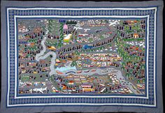 Hmong story cloth paj ntaub (pronounced pan dau). Story of how Hmong moved from their original China homeland to Laos and Berma, fought in the VietNam war, became refugees and came to the U.S.