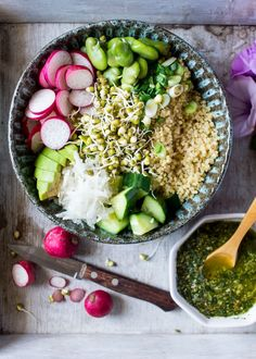 Superfood buddha bowl with mint pesto celebrates spring produce. It's a quick and healthy, vegan and gluten-free meal packed with flavour and texture.