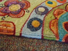 Why didn't I ever think to match yarn for whipped edge with color of hooking wool? ~ Sorry I don't know who did the hooking of this darling rug. ~