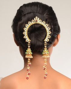 The Maharashtrian bride ties her hair into a neat, round bun (ambada) and…